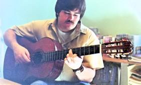 Tom playing his Hernandez Grand Concert guitar